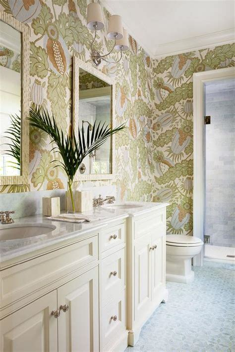 Tropical bathroom with carnival wallpaper and cream vanity cabinets cottage bathroom