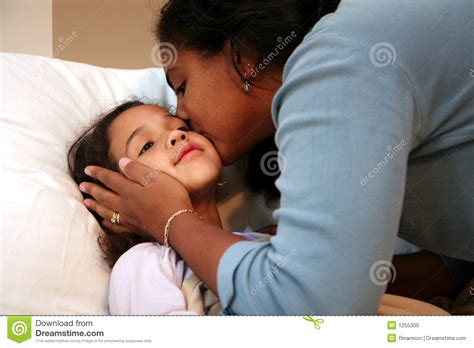 bed moms mom tucking child into bed royalty free stock photo image 1255305