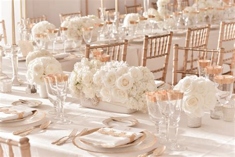 ivory wedding centerpieces with gold table