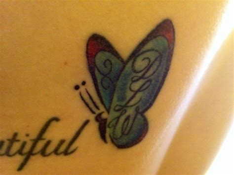 butterfly tattoo with initials tattoos pinterest