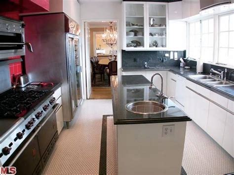 what colors make a kitchen look bigger white paint makeover how to make a room look larger