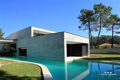 home design story pool concrete look home with wooden plank exterior
