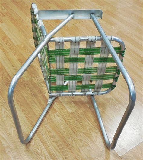 vintage green white aluminum webbed folding lawn chair