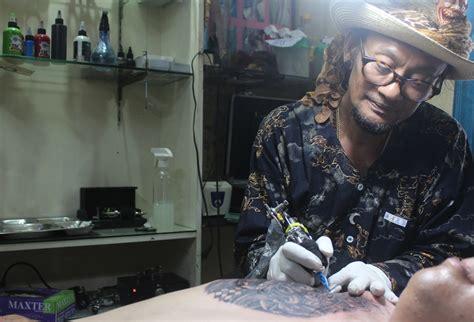 Topeng Tertawa Khas Bali T018 lionk merekam perkembangan tato di bali