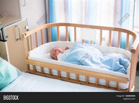 Co Sleeper For Larger Babies by Newborn Baby In Hospital Room New Born Child In Wooden Co