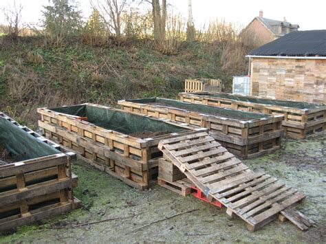 pallet garden bed old pallets used to make a raised garden cool now i don t