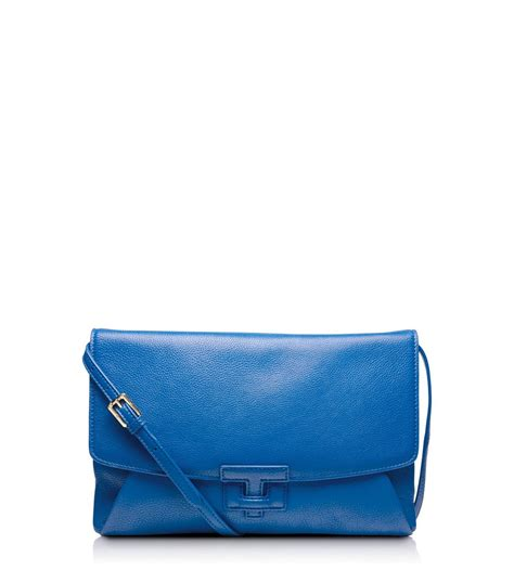burch leather t closure clutch in blue evening sky lyst