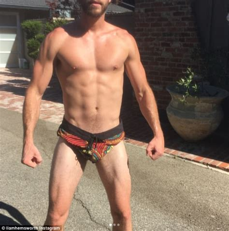 Liam Hemsworth Flaunts Ripped Physique In Tiny Shorts Daily Mail Online