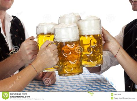 bavarian group toast with oktoberfest beer stein stock