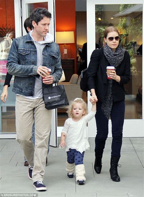 Amy Adams keeps fiance Darren Le Gallo grounded with a tight grip on way to the gym   Daily Mail