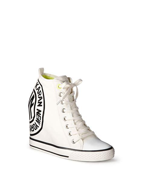dkny wedge sneakers on sale dkny grommet sneaker wedge with token in white lyst