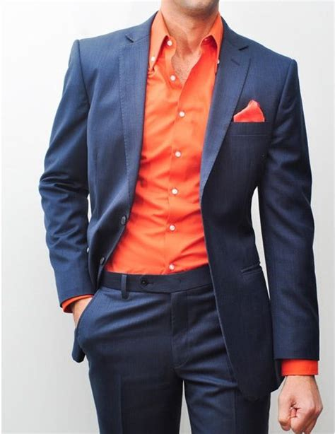 suit colors navy suit with bright reddish orange shirt and pocket