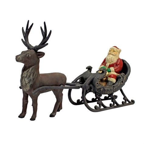 christmas santa on sleigh with reindeer die cast iron