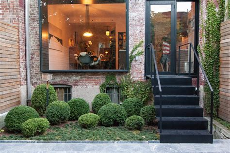backyard brooklyn brooklyn brownstone stair into backyard with shrub garden