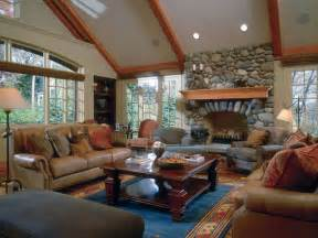 vaulted living room living room with full stone fireplace and vaulted ceiling traditional living room