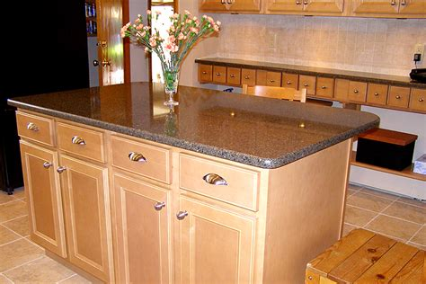 Quartz Countertops With Natural Maple Cabinets
