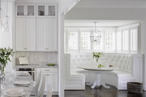 white banquette white tufted built in banquette transitional kitchen