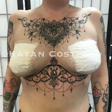 chest tattoo around nipple chest piece and underboob tattoo by katan costello two
