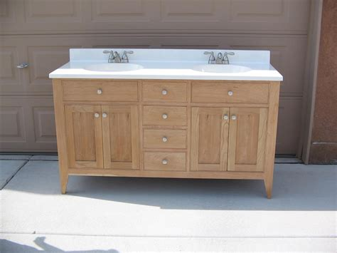 shaker style cherry bath vanity with a 2 sink top