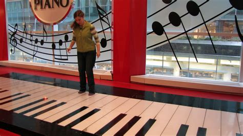 piano on concrete floor jamming on the big fao schwarz floor piano