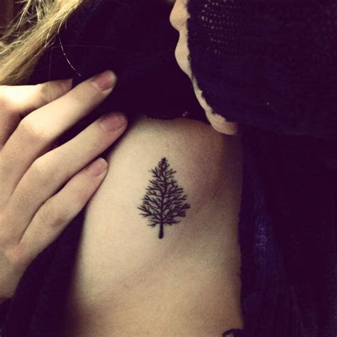 small body tattoos black simple minimal tree ribs symbolic