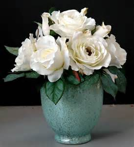white flowers in vases vases