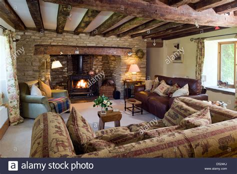 cottage living a cosy cottage living room with a log burning stove