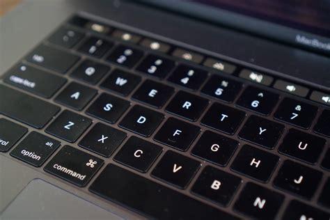 apple introduces keyboard service program  mac laptops
