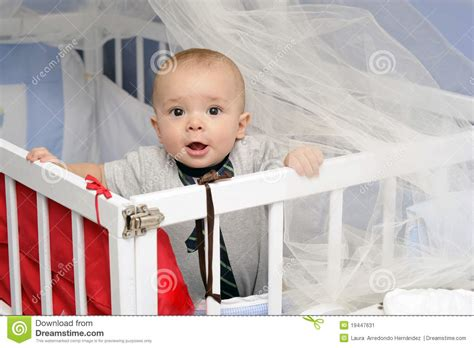 Baby In A Crib Stock Image Image 19447631 Baby Standing In Crib