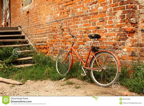 wallpaper for walls in mira road old bicycle on the background of red brick walls stock