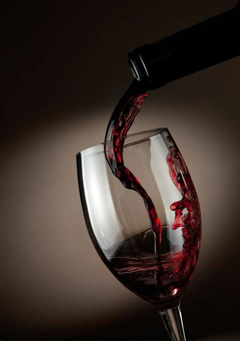 red wine pouring  glass  dark background wall mural