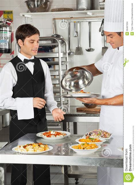 Giving Kitchen by Chef Giving Customer S Food To Waiter Stock Images Image