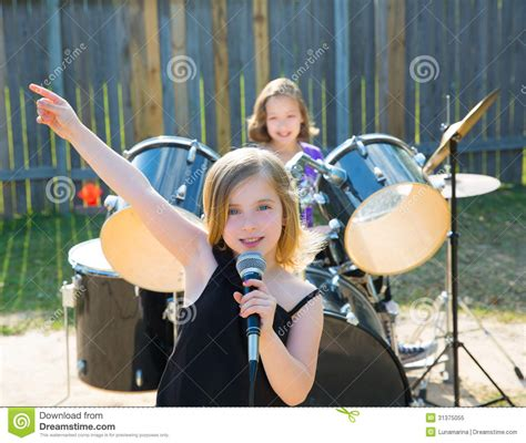 backyard band gogo downloads chidren singer girl singing playing live band in backyard