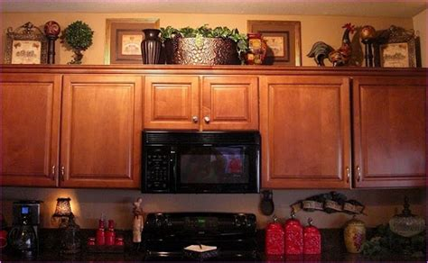 how to decorate on top of kitchen cabinets decorating top of kitchen cabinets