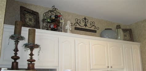 Cabinet Top Decor by What To Decorate The Top Of Kitchen Cabinets With Home