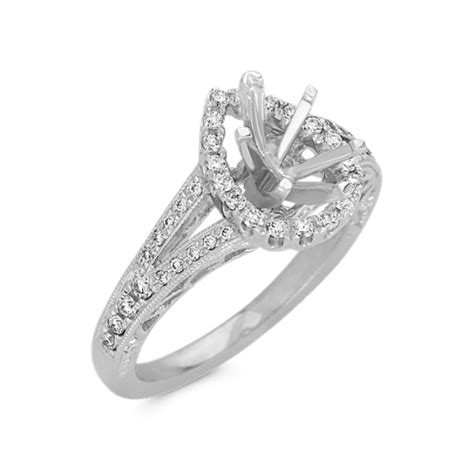 pear shaped halo engagement ring with pav 233 setting