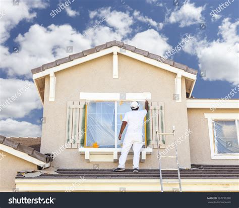 find a house painter busy house painter painting the trim and shutters of a home stock photo 267736388 shutterstock