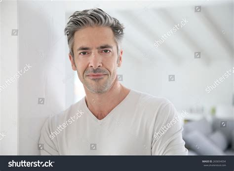 how can a 50 year old man look younger portrait of attractive 50 year old man stock photo