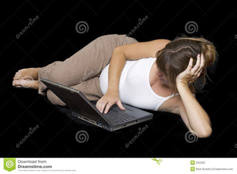 pregnant woman lying down pregnant woman surfing the net stock photo image 224320