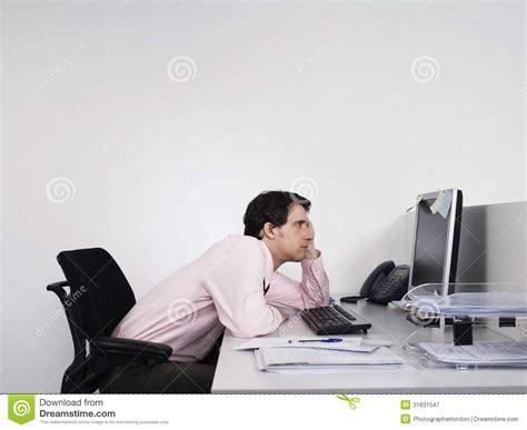 Office Worker At Desk Bored Office Worker At Desk Stock Image Image 31831547