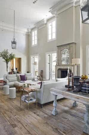 gorgeous dark walls and high ceilings with minimal but traditional statement furniture pieces double volume living room dream house pinterest