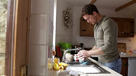 Kitchen Sink And Cabinet by Man Washing Dishes In His Home Stock Footage Video Getty