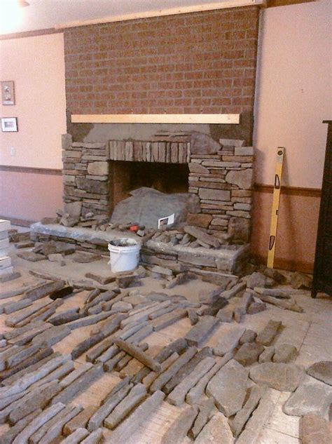 hometalk manufactured stone veneer   installed  dry stack   drab brick fireplace