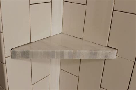 Badezimmer Fliesen Regal by How To Install A Tile Shower Corner Shelf