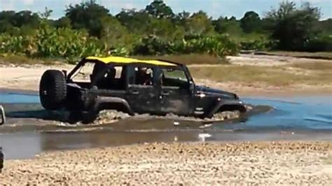 jeep water jeep wrangler 2014 swimming in mud water at river ranch