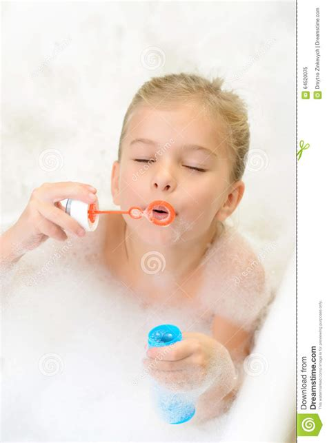 young little girls underground pleasant little girl playing in bath tube stock photo