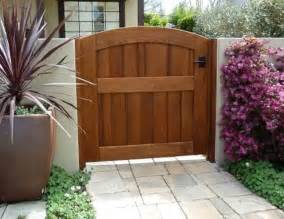 Outdoor Wood Gates Garden Wooden Gate Archtop Attached To Stucco Wall Using