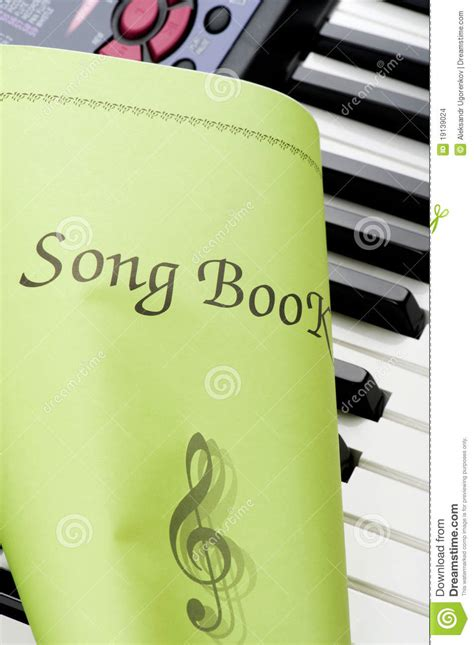 songs with our closed books piano keyboard with song book up stock images