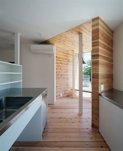 designboom japan house container design protrudes timber volume from traditional