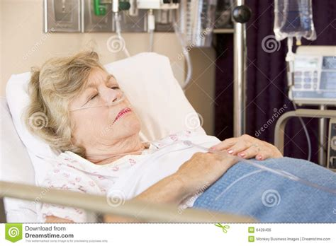 woman in hospital bed senior woman sleeping in hospital bed royalty free stock
